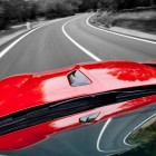 shiny glossy red car on road
