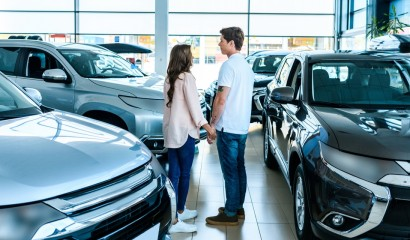 couple in car showroom