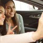 young car drivers with mobile phone