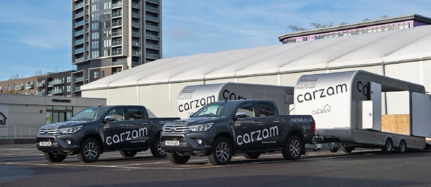 two carzam delivery trucks